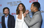 Zach Galifianakis, from left, Chrissy Teigen and John Legend arrive at the Los Angeles premiere of