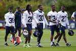 Seattle Seahawks defensive players (from left) Ryan Neal (35) Shaquill Griffin (26) Jamal Adams (33), Linden Stephens (34) and Marquise Blair (27) walk off the field following NFL football training camp, Monday, Aug. 24, 2020, in Renton, Wash. (AP Photo/Ted S. Warren, Pool)