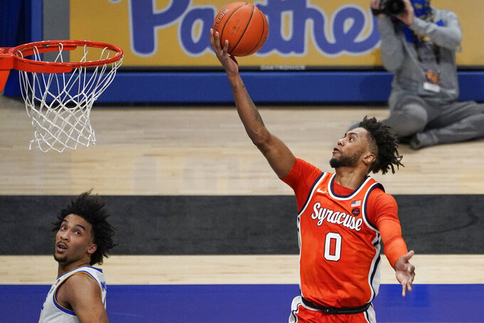 Syracuse's Alan Griffin (0) shoots as Pittsburgh's Justin Champagnie, left, watches during the second half of an NCAA college basketball game, Saturday, Jan. 16, 2021, in Pittsburgh. (AP Photo/Keith Srakocic)