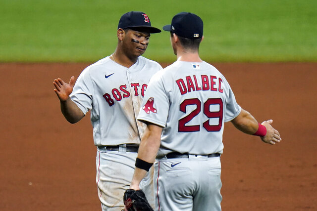 Boston Red Sox third baseman Rafael Devers, left, and first baseman Bobby Dalbec celebrate after the team defeated the Tampa Bay Rays during a baseball game Thursday, Sept. 10, 2020, in St. Petersburg, Fla. (AP Photo/Chris O'Meara)