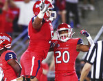 Fresno State's Netane Muti, left, celebrates a touchdown by Ronnie Rivers, right, against Minnesota during an NCAA college football game Saturday, Sept. 7, 2019, in Fresno, Calif. (Eric Paul Zamora/The Fresno Bee via AP)