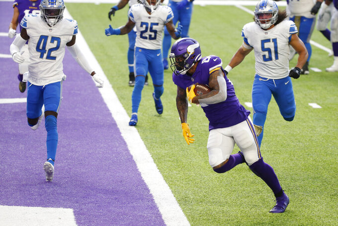 Minnesota Vikings tight end Irv Smith Jr. (84) scores on a 1-yard touchdown reception ahead of Detroit Lions safety Jayron Kearse (42) during the second half of an NFL football game, Sunday, Nov. 8, 2020, in Minneapolis. (AP Photo/Bruce Kluckhohn)