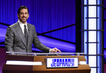 "This image released by Jeopardy Productions, Inc. shows Green Bay Packers quarterback Aaron Rodgers as he guest hosts the game show ""Jeopardy!"" Rodgers is hosting the popular game show for the next two weeks as the show goes through a series of guest hosts to replace Alex Trebek, who died of cancer on Nov. 8. (Carol Kaelson/Jeopardy Productions, Inc. via AP)"