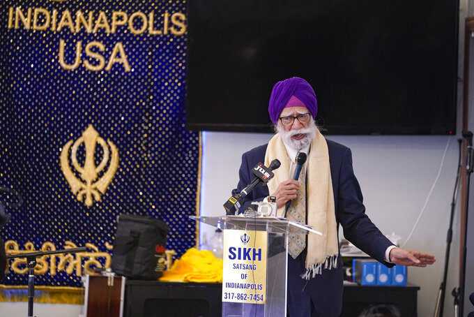 K.P. Singh speaks to members of the Sikh Coalition as they gather at the Sikh Satsang of Indianapolis in Indianapolis, Saturday, April 17, 2021 to formulate the groups response to the shooting at a FedEx facility in Indianapolis that claimed the lives of four members of the Sikh community. A gunman killed eight people and wounded several others before taking his own life in a late-night attack at a FedEx facility near the Indianapolis airport, police said.  (AP Photo/Michael Conroy)