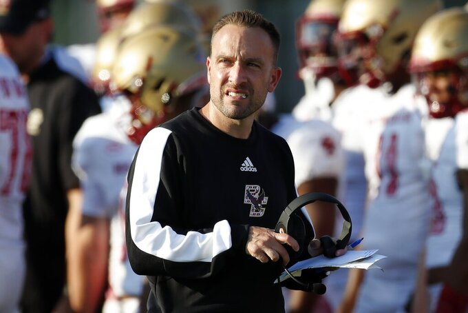 Boston College head coach Jeff Hafley stands on the field during a timeout in the second half of an NCAA college football game against Massachusetts, Saturday, Sept. 11, 2021, in Amherst, Mass. (AP Photo/Michael Dwyer)