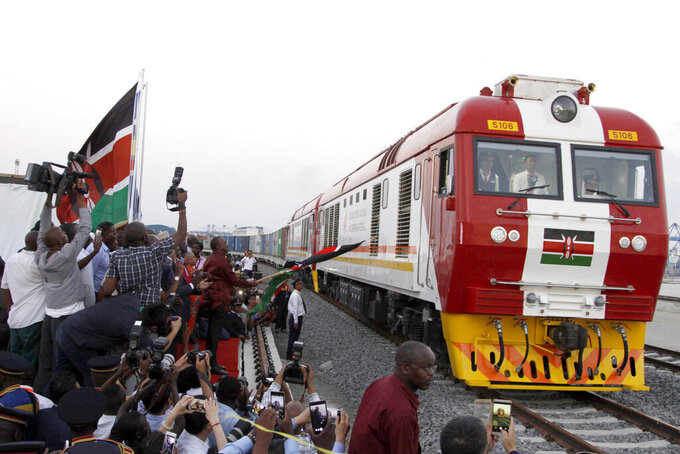 FILE - In this May 30, 2017, file photo, the SGR cargo train rides from the port containers depot on a Chinese-backed railway costing nearly $3.3 billion, opened by Kenya's president as one of the country's largest infrastructure project since independence, in Mombasa, Kenya. China's loans to poor countries in Africa and Asia impose unusual secrecy and repayment terms that are hurting their ability to renegotiate debts after the coronavirus pandemic, a group of U.S. and German researchers said in a report Wednesday, March 31, 2021. (AP Photo/Khalil Senosi, File)