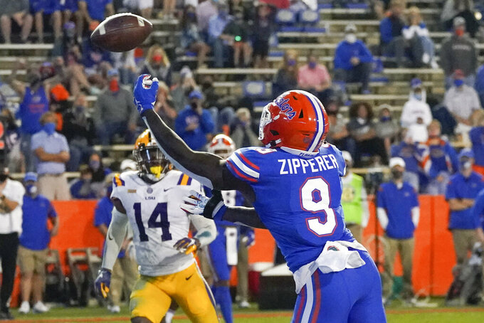 Florida tight end Keon Zipperer (9) can't hang on to a pass in front of LSU safety Maurice Hampton Jr. (14) during the first half of an NCAA college football game Saturday, Dec. 12, 2020, in Gainesville, Fla. (AP Photo/John Raoux)