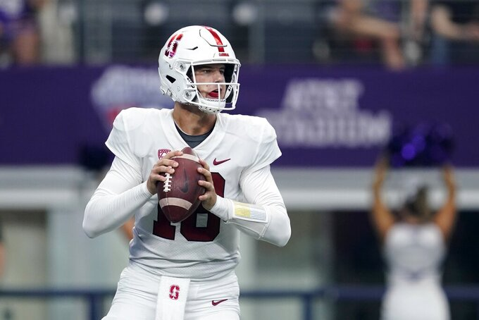 Stanford quarterback Tanner McKee (18) drops back to throw a pass in the first half of an NCAA college football game against Kansas State in Arlington, Texas, Saturday, Sept. 4, 2021. (AP Photo/Tony Gutierrez)