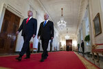 President Donald Trump walks with Israeli Prime Minister Benjamin Netanyahu to an event in the East Room of the White House in Washington, Tuesday, Jan. 28, 2020, to announce the Trump administration's much-anticipated plan to resolve the Israeli-Palestinian conflict. (AP Photo/Alex Brandon)