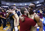 FILE - In this March 6, 2018, file photo, College of Charleston's Joe Chealey, right, shows his emotions after defeating Northeastern 83-76 in overtime of an NCAA college championship basketball game in the Colonial Athletic Association tournament at the North Charleston Coliseum in North Charleston, S.C. Chealey scored 32 points as Charleston erased a 17-point, second-half deficit. (AP Photo/Mic Smith, File)