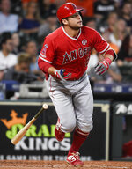 Los Angeles Angels' David Fletcher watches his bloop RBI single during the second inning of a baseball game against the Houston Astros, Saturday, Sept. 21, 2019, in Houston. (AP Photo/Eric Christian Smith)