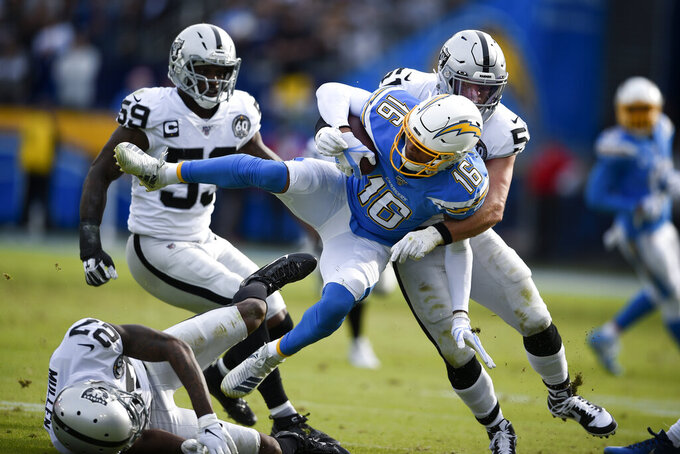 Los Angeles Chargers wide receiver Andre Patton is tackled by Oakland Raiders inside linebacker Will Compton during the first half of an NFL football game Sunday, Dec. 22, 2019, in Carson, Calif. (AP Photo/Kelvin Kuo)