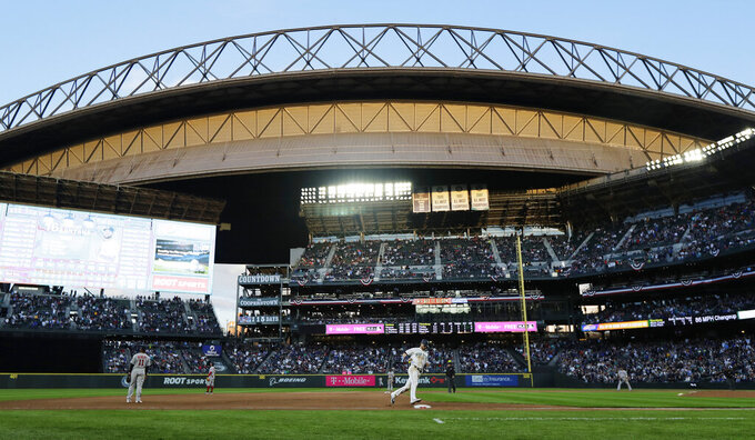 Seattle Mariners' Mitch Haniger rounds third base at T-Mobile Park on his way to scoring a run on a two-run home run by Domingo Santana during the seventh inning of a baseball game Thursday, March 28, 2019, in Seattle. (AP Photo/Ted S. Warren)