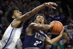 Monmouth forward Nikkei Rutty (21) shoots as Kansas State forward Antonio Gordon, left, defends during the first half of an NCAA college basketball game in Manhattan, Kan., Wednesday, Nov. 13, 2019. (AP Photo/Orlin Wagner)