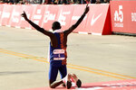 Lawrence Cherono, of Kenya, celebrates after winning Sunday's Chicago Marathon, Sunday, Oct. 13, 2019, in Chicago. (AP Photo/Paul Beaty)