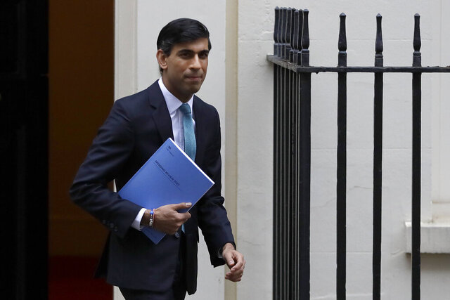 FILE - In this file photo dated Wednesday, Nov. 25, 2020, Britain's Chancellor of the Exchequer Rishi Sunak leaves Downing Street in London.  Treasury chief Sunak has committed to ending the widely unpopular tax on women's sanitary products, but the change could only take effect Friday Jan 1, 2021, after Britain had finally left the economic orbit of the EU.(AP Photo/Kirsty Wigglesworth, FILE)