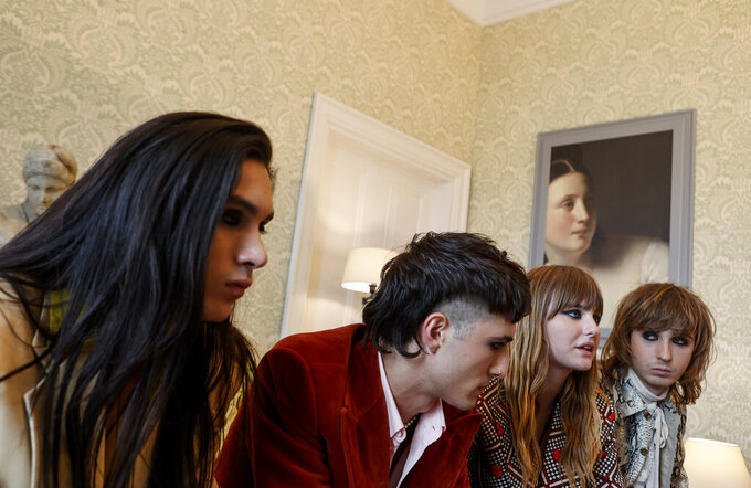 From left, Ethan Torchio, Damiano David, Victoria De Angelis and Thomas Raggi, of Italian band Maneskin, winners of the Eurovision Song Contest in May, are interviewed by the Associated Press at a hotel in Rome, Tuesday, July 27, 2021. (AP Photo/Riccardo De Luca)