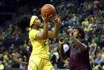 Oregon's Minyon Moore, left, goes up to shoot against Texas Southern's Ciani Cryor during the first quarter of an NCAA college basketball game in Eugene, Ore., Saturday, Nov. 16, 2019. (AP Photo/Chris Pietsch)