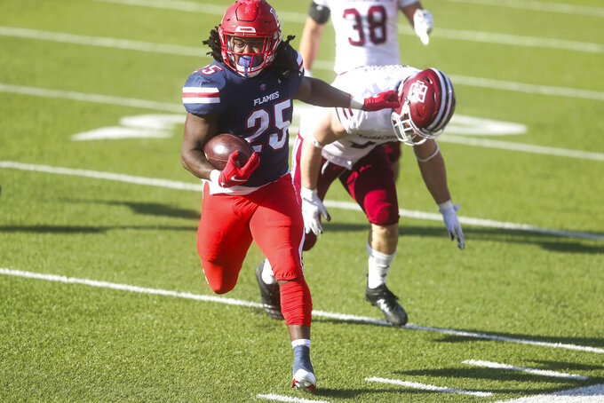 Liberty running back Peytton Pickett (25) carries the ball before he is pushed out of bound during the second half of a NCAA college football game against Massachusetts on Friday, Nov. 27, 2020, at Williams Stadium in Lynchburg, Va. (AP Photo/Shaban Athuman)