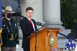 Ian Merrill, son of former Gov. Steve Merrill, thanks attendees at his father's memorial service outside the Statehouse on Friday, Sept. 11, 2020, in Concord, N.H. Merrill, a Republican who served two terms in the 1990s, died Sept. 5 at age 74. (AP Photo/Holly Ramer)