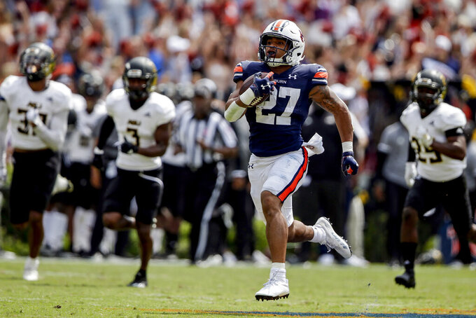Auburn running back Jarquez Hunter (27) breaks away for a touchdown against Alabama State during the second half of an NCAA football game Saturday, Sept. 11, 2021, in Auburn, Ala. (AP Photo/Butch Dill)
