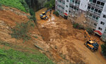 Mud from a landslide hit a parking lot at an apartment in Geoje, South Korea, Monday, Sept. 7, 2020. A powerful typhoon damaged buildings, flooded roads and knocked out power to thousands of homes in South Korea on Monday after battering islands in southern Japan. More than 20 people were injured. (Kim Dong-min/Yonhap via AP)