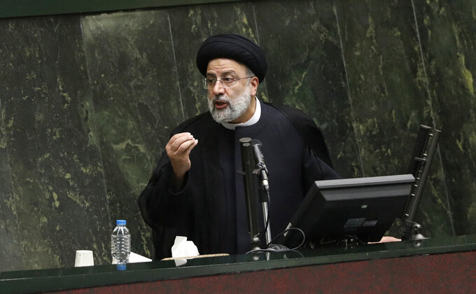 President Ebrahim Raisi defends his proposed ministers in a session of parliament, in Tehran, Iran, Wednesday, Aug. 25, 2021. Iran's hard-liner dominated parliament Wednesday voted to approve most of the proposed ministers of the newly elected president. (AP Photo/Vahid Salemi)