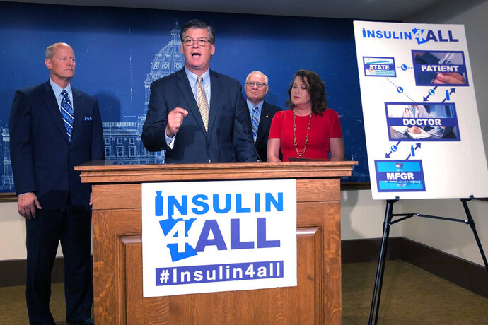 Minnesota Senate Republican leaders propose a plan to require drug makers to provide free insulin to qualifying residents who can't afford the high cost of the life-saving medication, Thursday, Sept. 19, 2019, in St. Paul, Minn. Pictured left to right at a news conference at the state Capitol are Senate Majority Leader Paul Gazelka, Sen. Eric Pratt at the podium, Sen. Dan Hall and Sen. Michelle Benson. (AP Photo/Steve Karnowski)