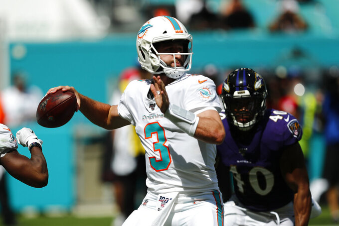 Miami Dolphins quarterback Josh Rosen (3) looks to pass, during the second half at an NFL football game against the Baltimore Ravens, Sunday, Sept. 8, 2019, in Miami Gardens, Fla. (AP Photo/Brynn Anderson)
