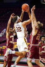 Minnesota's Gabe Kalscheur (22) shoots as Boston College's Rich Kelly (22) defends during the first half of an NCAA college basketball game Tuesday, Dec. 8, 2020, in Minneapolis. (AP Photo/Jim Mone)