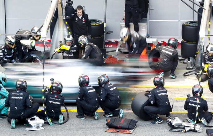 Mercedes-AMG Petronas' Lewis Hamilton makes a pit stop during a Formula One pre-season testing session at the Barcelona Catalunya racetrack in Montmelo, outside Barcelona, Spain, Wednesday, Feb. 19, 2020. (AP Photo/Joan Monfort)