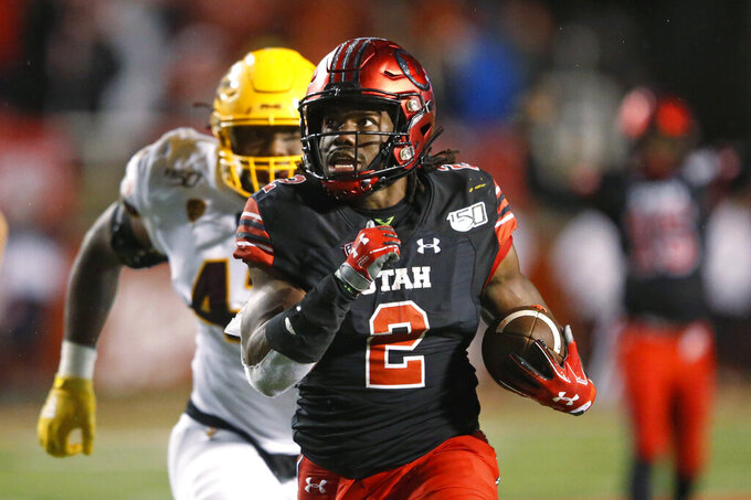 Utah running back Zack Moss (2) heads for a touchdown against Arizona State during the second half of an NCAA college football game Saturday, Oct. 19, 2019, in Salt Lake City. (AP Photo/Rick Bowmer)