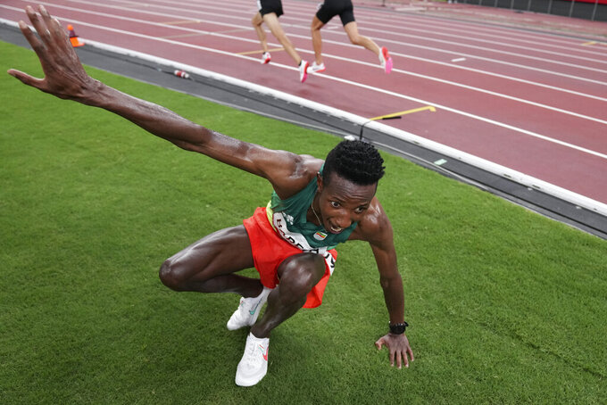 Selemon Barega, of Ethiopia, celebrates after winning the men's 10,000-meters final at the 2020 Summer Olympics, Friday, July 30, 2021, in Tokyo. (AP Photo/Matthias Schrader)