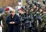 FILE - In this Tuesday, Nov. 14, 2006, file photo, German Chancellor Angela Merkel talks to German Army soldiers during her visit at the Army Training Center of the German Armed Forces in Letzlingen, Germany. After 100 years, the German army will get military rabbis again. Chancellor Angela Merkel's Cabinet unanimously passed a ruling on Wednesday to reinstall Jewish religious counseling in the army. (AP Photo/Markus Schreiber)