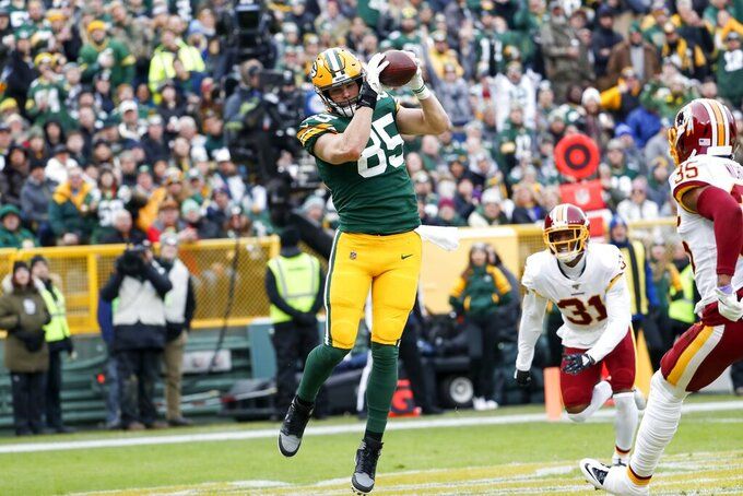 Green Bay Packers' Robert Tonyan catches a touchdown pass during the first half of an NFL football game against the Washington Redskins Sunday, Dec. 8, 2019, in Green Bay, Wis. (AP Photo/Matt Ludtke)