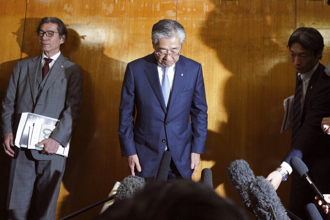 FILE - In this March 19, 2019, file photo, International Olympics Committee member and head of the Japanese Olympic Committee Tsunekazu Takeda bows as he speaks after a JOC executive board meeting in Tokyo. rench prosecutors believe Tokyo landed the Olympics by channeling bribes to IOC voters. Takeda, an IOC member at the time and head of the Japanese Olympic Committee, was forced to resign two years ago in the vote-buying scandal. (AP Photo/Eugene Hoshiko, File)