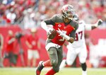 Tampa Bay Buccaneers quarterback Jameis Winston (3) runs the ball during the fourth quarter at Raymond James Stadium in Tampa, Florida on Sunday, December 29, 2019. The Atlanta Falcons defeated the Tampa Bay Buccaneers 28-22 in overtime.(Octavio Jones/Tampa Bay Times via AP)