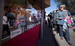 Shoppers at the Fourth Avenue Street Fair look at the caramel apples from San Francisco Chocolate Factory's booth during the 50th annual Fourth Avenue Winter Street in Tucson, Ariz., on Dec. 13, 2019. Tucson's Fourth Avenue Winter Street Fair has been canceled. The fallout from the coronavirus pandemic has dealt a punishing blow to the southern Arizona city where dozens of winter and spring events normally attract crowds big and small. (Rebecca Sasnett/Arizona Daily Star via AP)
