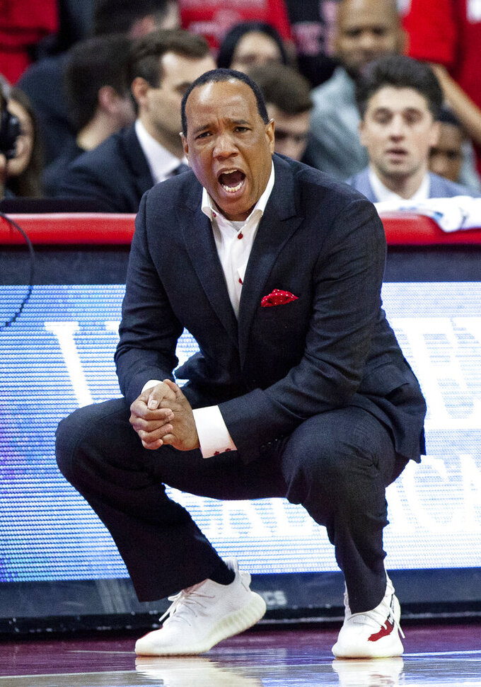File-This Jan. 26, 2019, file photo shows North Carolina State coach Kevin Keatts shouting to his team during the first half of an NCAA college basketball game against Clemson in Raleigh, N.C. Keatts' No. 23 NC State team faces No. 3 Virginia and No. 12 Virginia Tech in the Atlantic Coast Conference this week. (AP Photo/Ben McKeown, File)