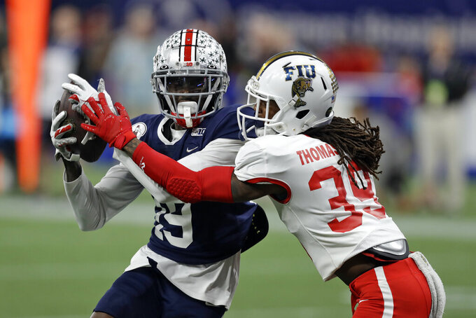 West wide receiver Binjimen Victor, of Ohio State, (19) pulls in a touchdown pass in front of East cornerback Stantley Thomas-Oliver III, of Florida International University, (39) during the second half of the East West Shrine football game Saturday, Jan. 18, 2020, in St. Petersburg, Fla. (AP Photo/Chris O'Meara)