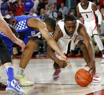 Georgia guard Tye Fagan (14) and Kentucky guard Keldon Johnson (3) reach for a loose ball during the first half of an NCAA college basketball game Tuesday, Jan. 15, 2019, in Athens, Ga. Kentucky won 69-49. (AP Photo/John Bazemore)