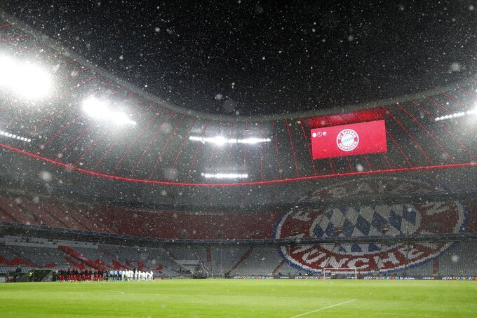 Snow falls over the stadium before the Champions League quarterfinal soccer match between Bayern Munich and Paris Saint Germain in Munich, Germany, Wednesday, April 7, 2021. (AP Photo/Matthias Schrader)