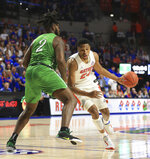 Florida forward Kerry Blackshear Jr. (24) dribbles around Marshall forward Iran Bennett (2) during the first half of an NCAA college basketball game Friday, Nov. 29, 2019, in Gainesville, Fla. (AP Photo/Matt Stamey)