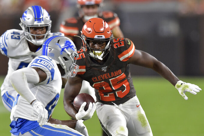 Cleveland Browns running back Dontrell Hilliard (25) runs for a first down during the first half of the team's NFL preseason football game against the Detroit Lions, Thursday, Aug. 29, 2019, in Cleveland. (AP Photo/David Richard)