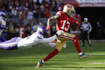 San Francisco 49ers wide receiver Richie James Jr. (13) tries to fend off a tackle by Minnesota Vikings defensive end Stephen Weatherly during the first half of an NFL divisional playoff football game, Saturday, Jan. 11, 2020, in Santa Clara, Calif. (AP Photo/Marcio Jose Sanchez)