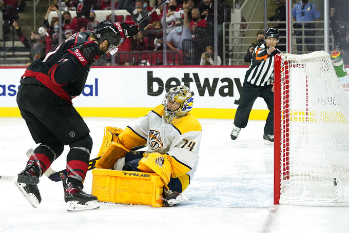 Carolina Hurricanes center Jordan Staal (11) reacts after scoring against Nashville Predators goaltender Juuse Saros (74) during overtime in Game 5 of an NHL hockey Stanley Cup first-round playoff series in Raleigh, N.C., Tuesday, May 25, 2021. (AP Photo/Gerry Broome)