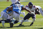 Chicago Bears running back David Montgomery (32) carries the ball against Tennessee Titans defensive tackle Jack Crawford (94) in the first half of an NFL football game Sunday, Nov. 8, 2020, in Nashville, Tenn. (AP Photo/Wade Payne)