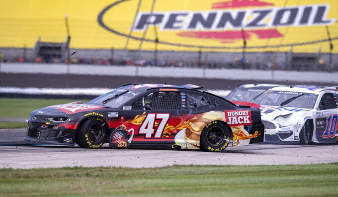 Ricky Stenhouse Jr. (47) loses control of his car at Turn 5 during a NASCAR Cup Series auto race at Indianapolis Motor Speedway, Sunday, Aug. 15, 2021, in Indianapolis. (AP Photo/Doug McSchooler)