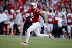 FILE- In this Oct. 20, 2018 file photo, Nebraska wide receiver Stanley Morgan Jr. (8) runs for a touchdown during the second half of an NCAA college football game against Minnesota in Lincoln, Neb. Morgan needs four receptions and 91 yards in the final two games to pass Kenny Bell in both categories on the Nebraska all-time receiving chart. (AP Photo/Nati Harnik, file)