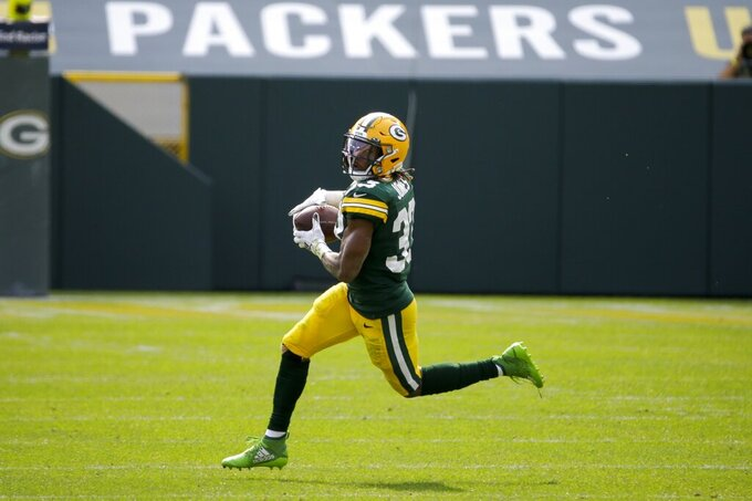 Green Bay Packers' Aaron Jones catches a pass during the first half of an NFL football game against the Detroit Lions Sunday, Sept. 20, 2020, in Green Bay, Wis. (AP Photo/Mike Roemer)